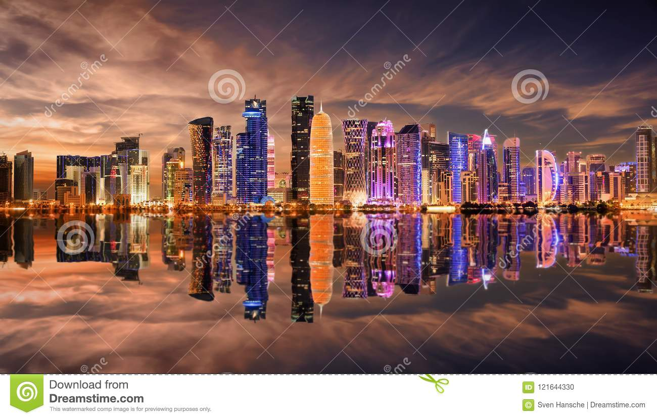 Panoramic View Of Illuminated Doha With Reflections In The