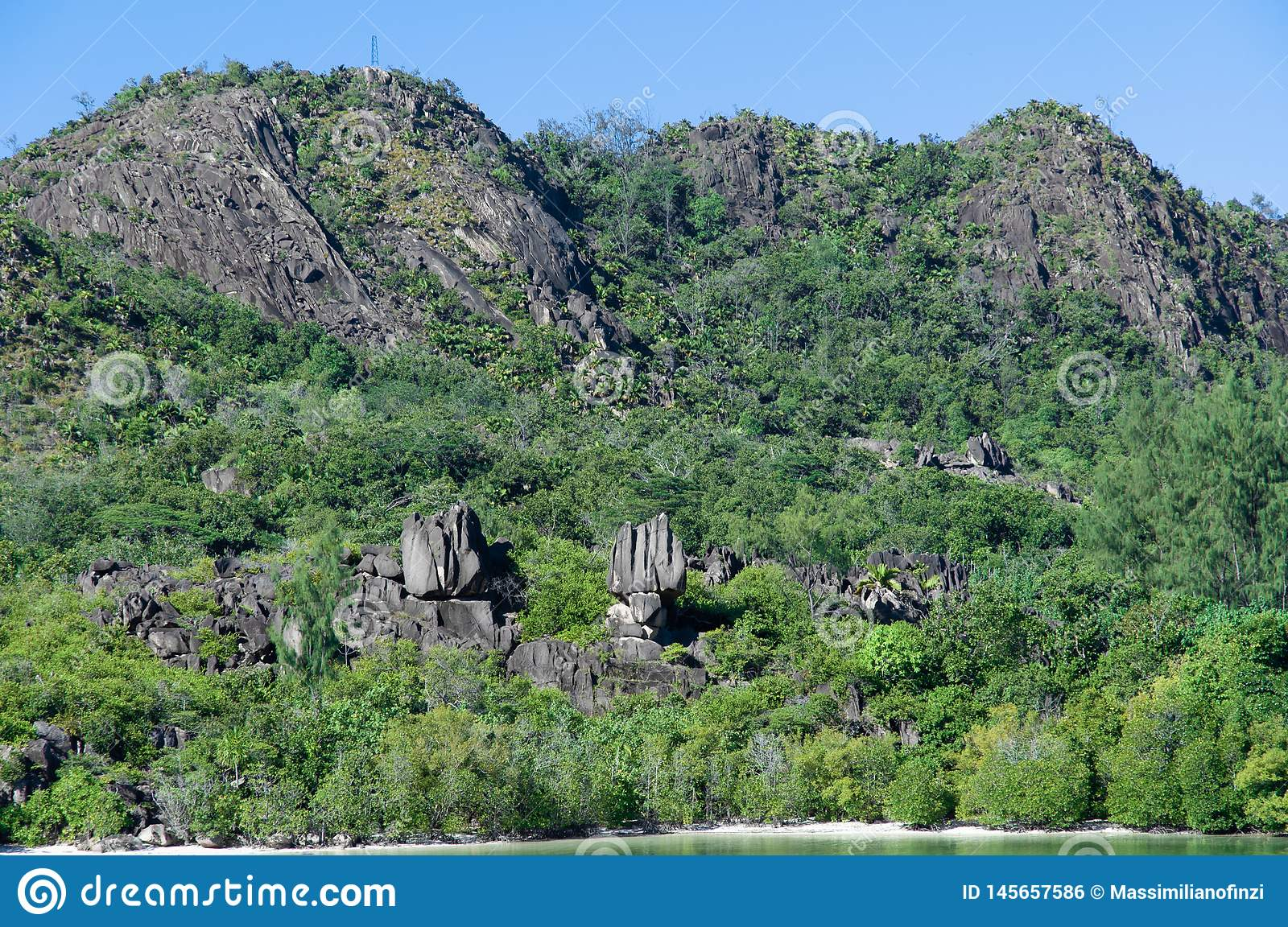 Lava stone formation, monolith, in the natural park of curieuse island, Seychelles
