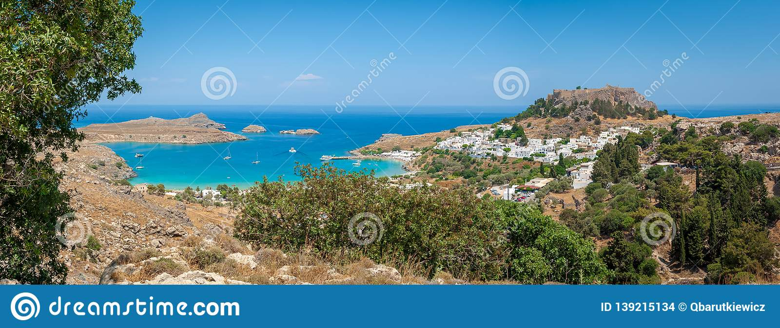 Panoramic view over Lindos village with ruins of ancient Acropolis. Island of Rhodes. Greece. Europe