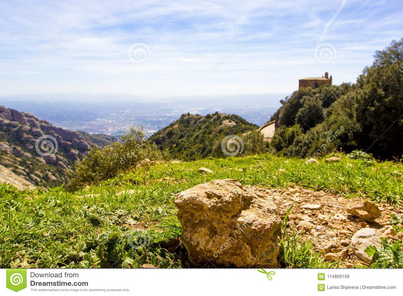 0a43f29f5f Panoramic view of Montserrat mountains with chapel near Santa Maria de  Montserrat Monastery