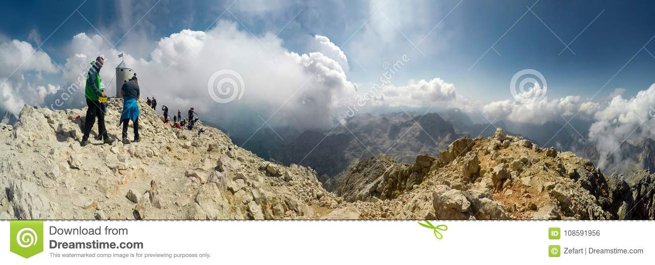 Panoramic view of Mountaineer expedition climbing to rocky mountain summit Triglav on Julian Alps