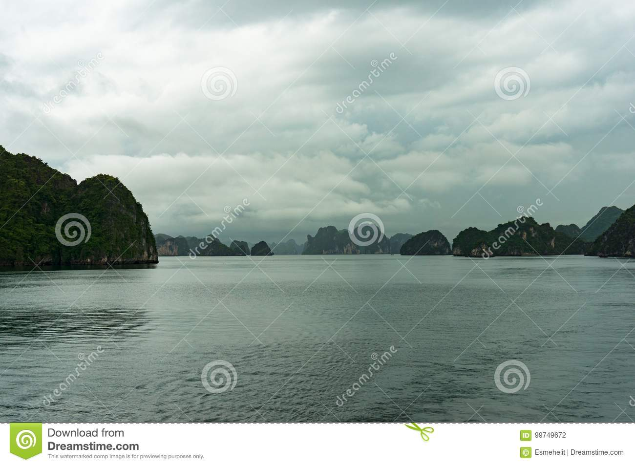 Panoramic view on scenic karst islands of Halong Bay on mist