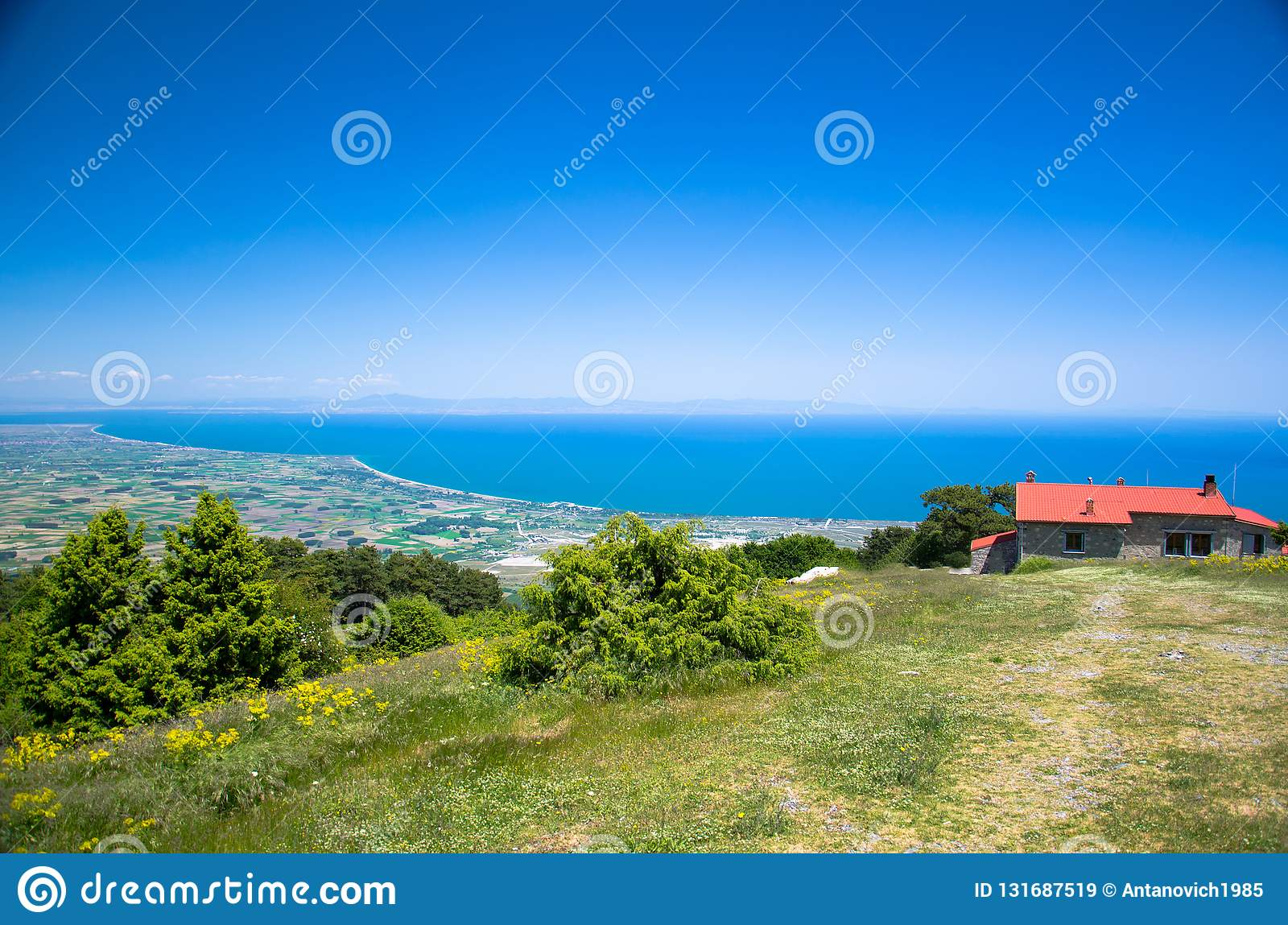 Panoramic view of Thermaikos Gulf of Aegean sea and Khalkidiki or Halkidiki peninsula seen from Olympus mountains near building of