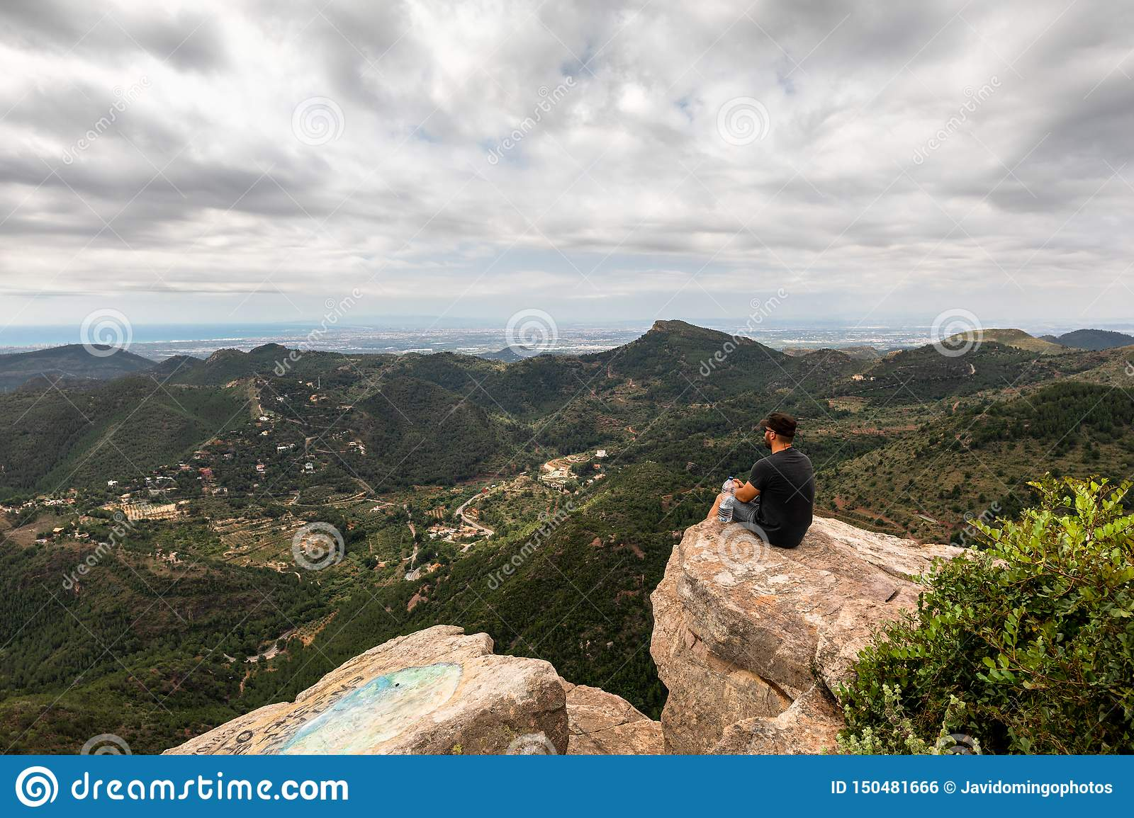 Panoramic View Of Tourist On Mountain Peak