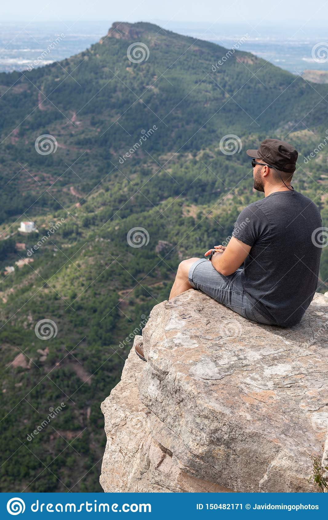 Panoramic View Of Tourist On Mountain Peak