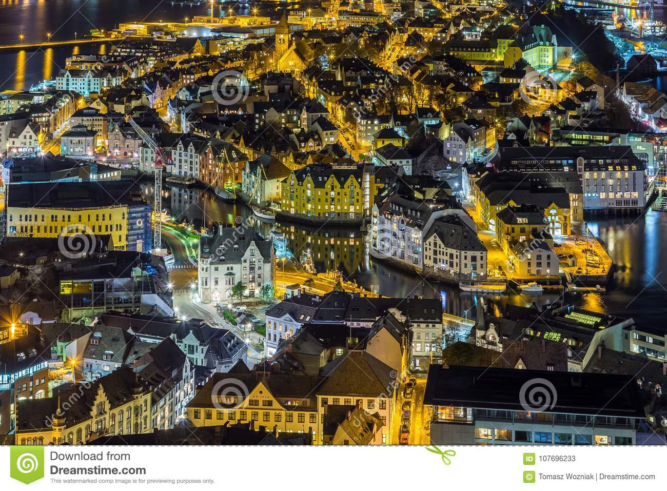 Panoramic view of the town of Alesund by night from Aksla hill.