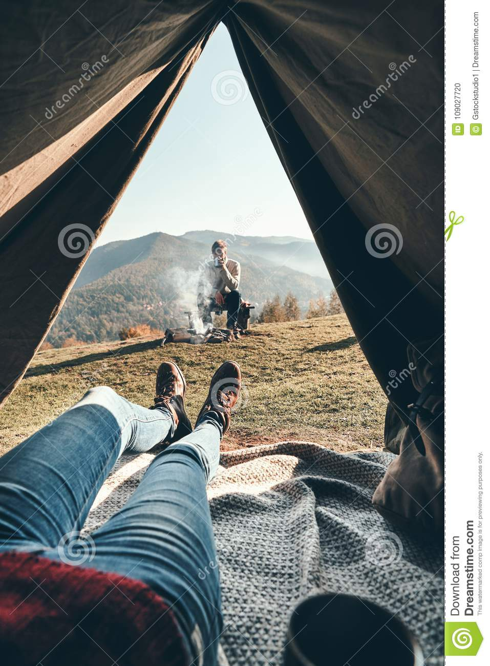Panoramic view. Woman enjoying the view of mountain range from t