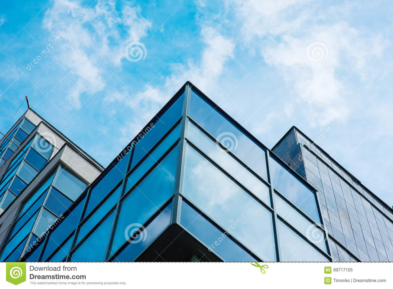 Panoramic wide angle view to steel blue background of glass high rise building skyscrapers in modern futuristic downtown
