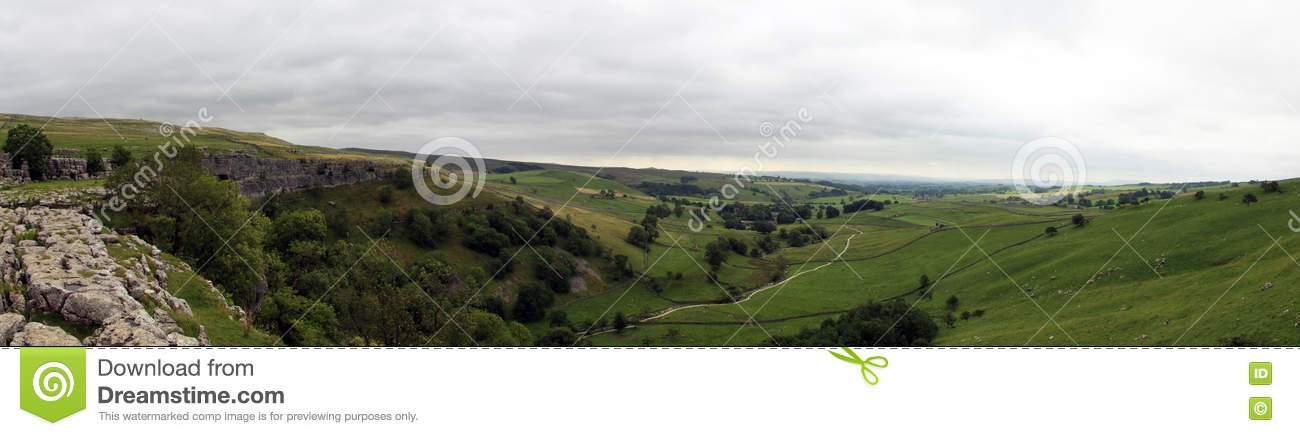 Panorma of Malham Cove landscape in Yorkshire Dales National Park in England on a cloudy day
