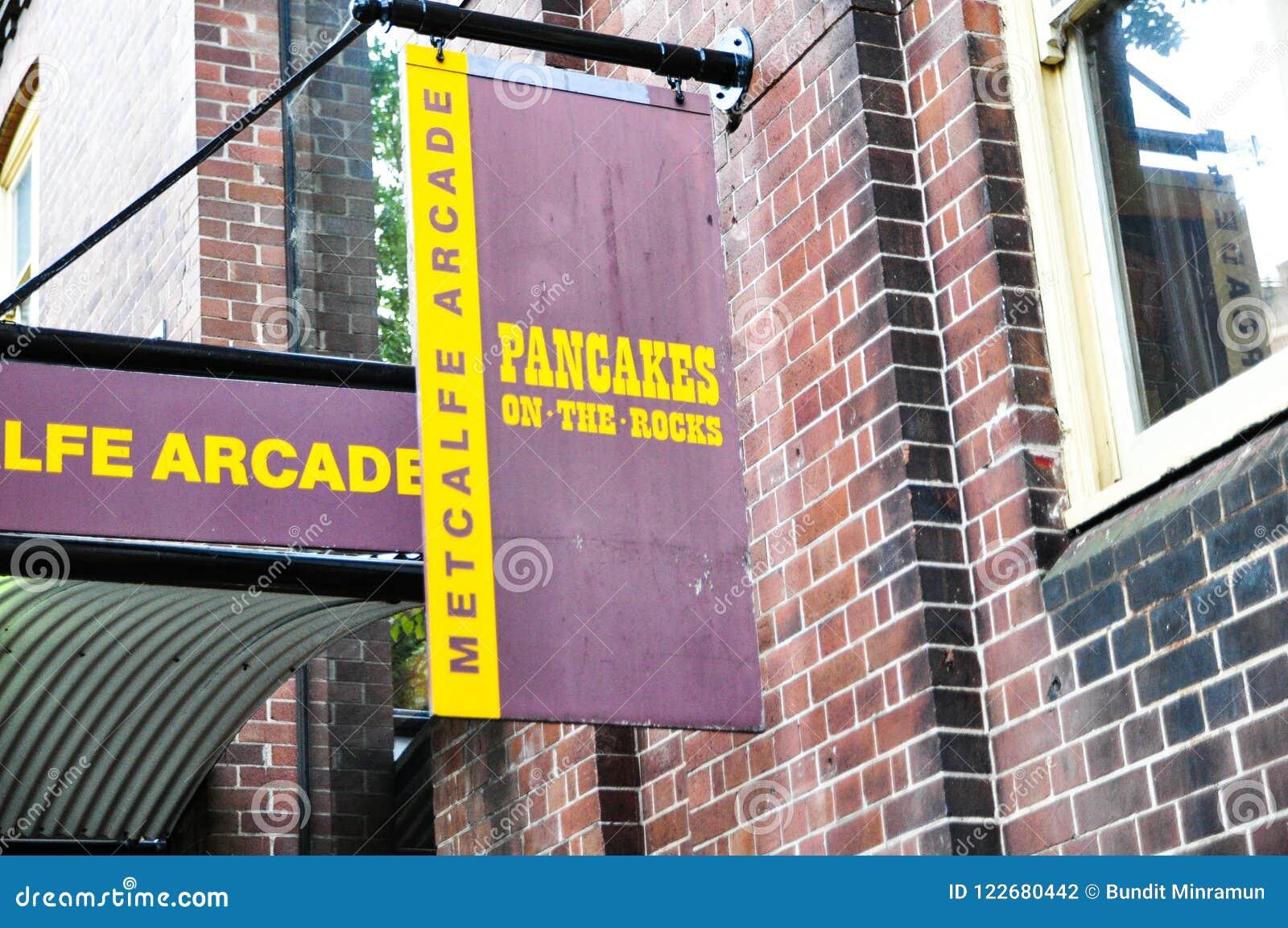 Panqueca no logotipo do restaurante da rocha, ele restaurante famoso do ` s em Sydney, situado na estrada de Hickson, nas rochas