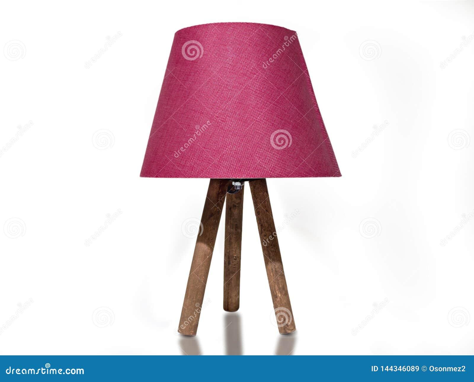 Pantalla rosada con las piernas de madera luz coloreada rosada de la noche