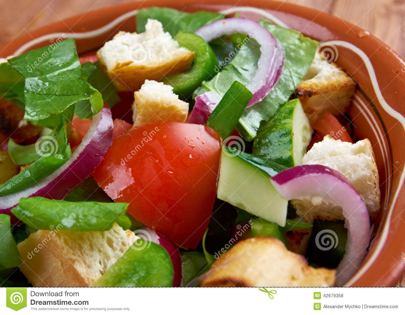Panzanella or panmolle is a Tuscan salad of bread and tomatoes.