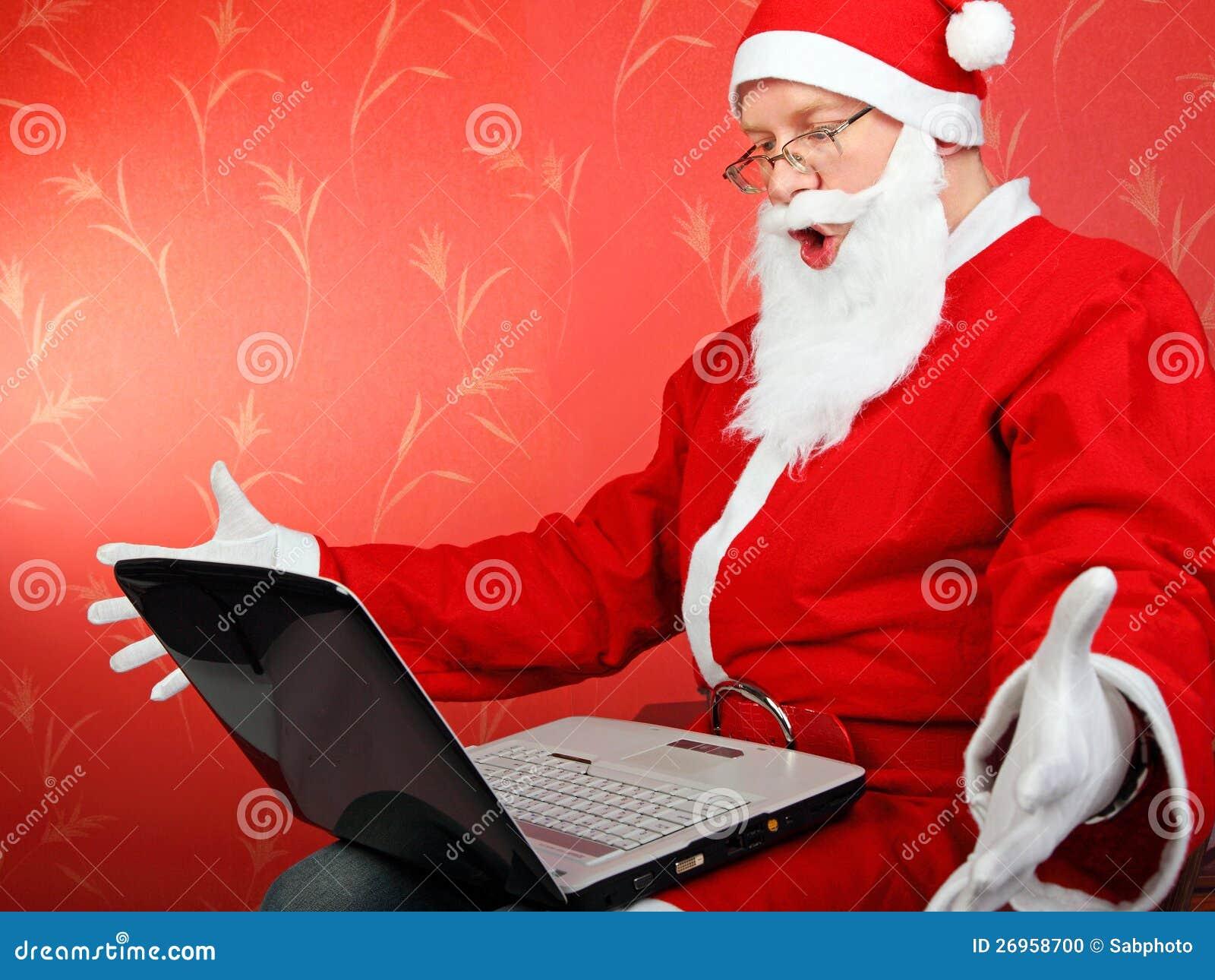 Papai Noel com portátil