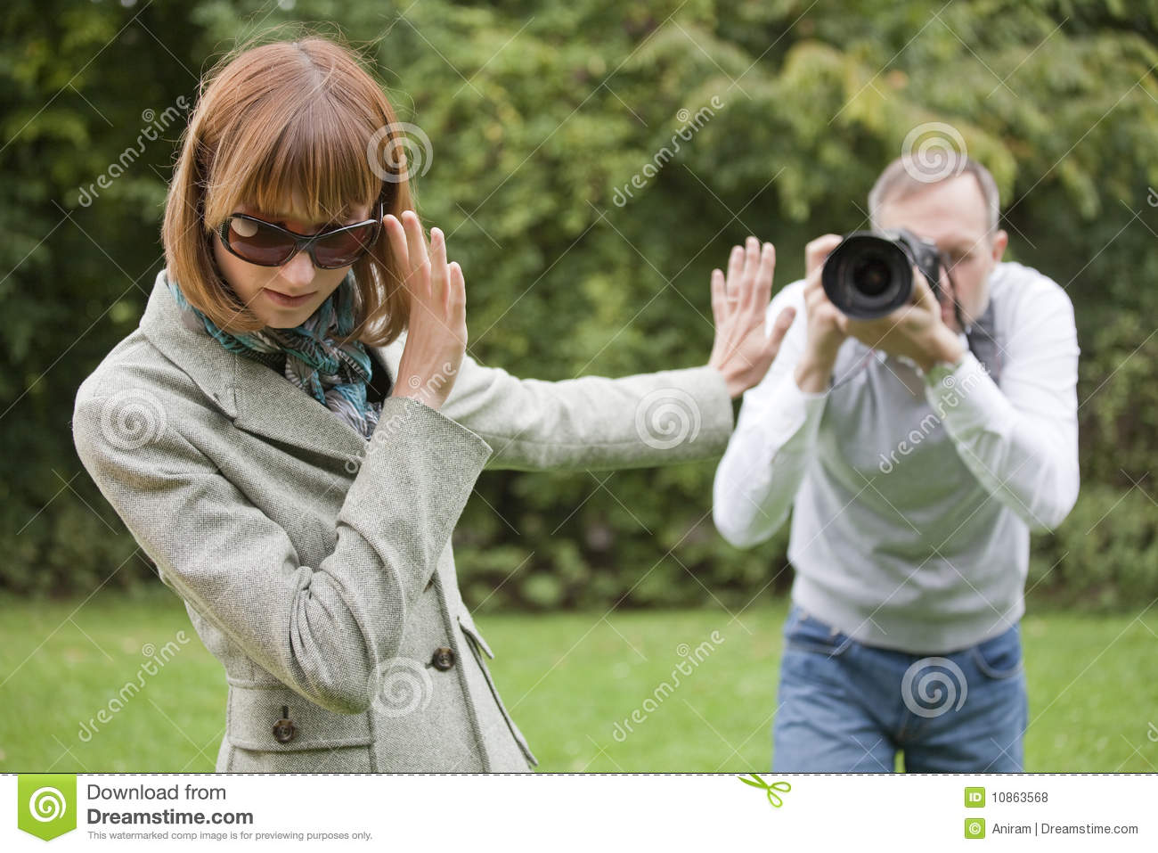 Paparazzi takes a picture from woman