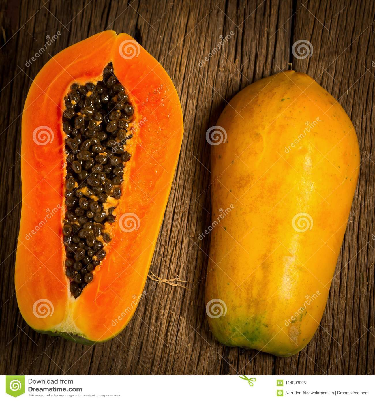 papaya fruit. half. seed. old wooden. moring. sunset. art. asian