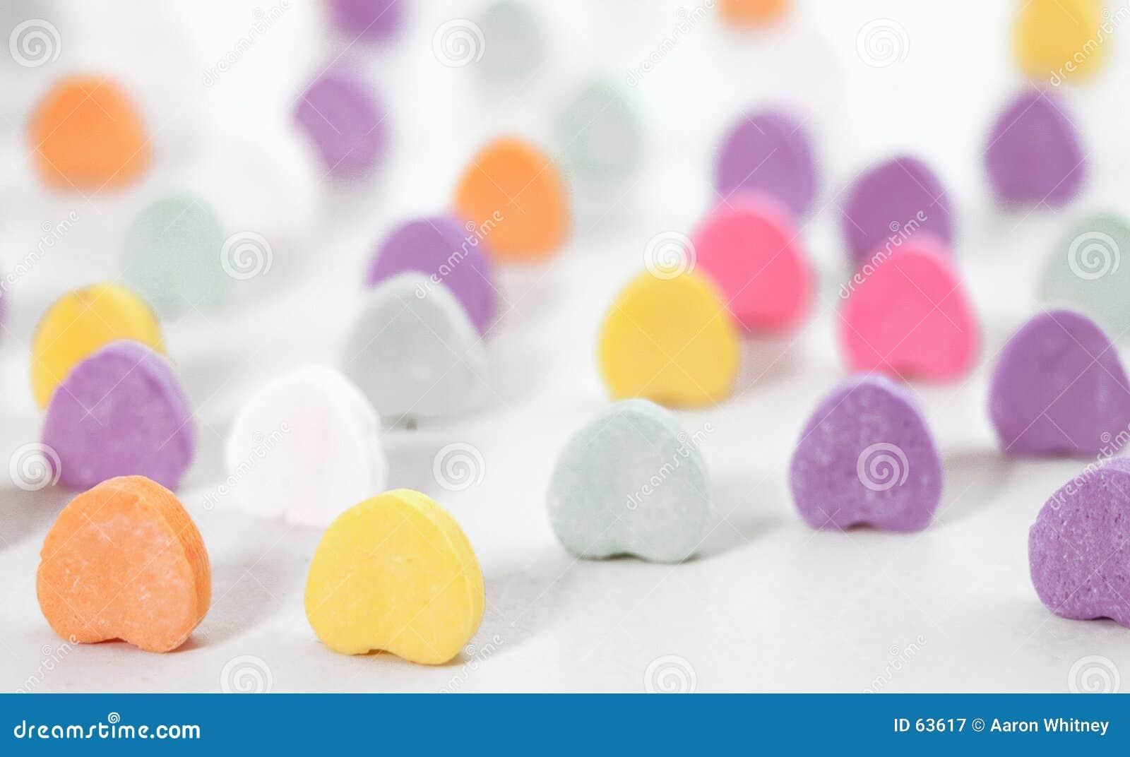 Papel pintado de los corazones del caramelo