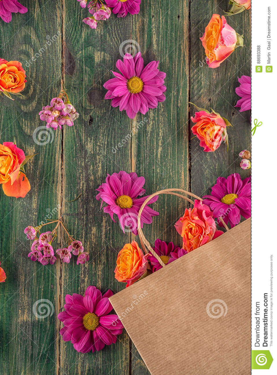 Paper bag with flowers on wooden background shopping time or time download paper bag with flowers on wooden background shopping time or time for sales stock mightylinksfo