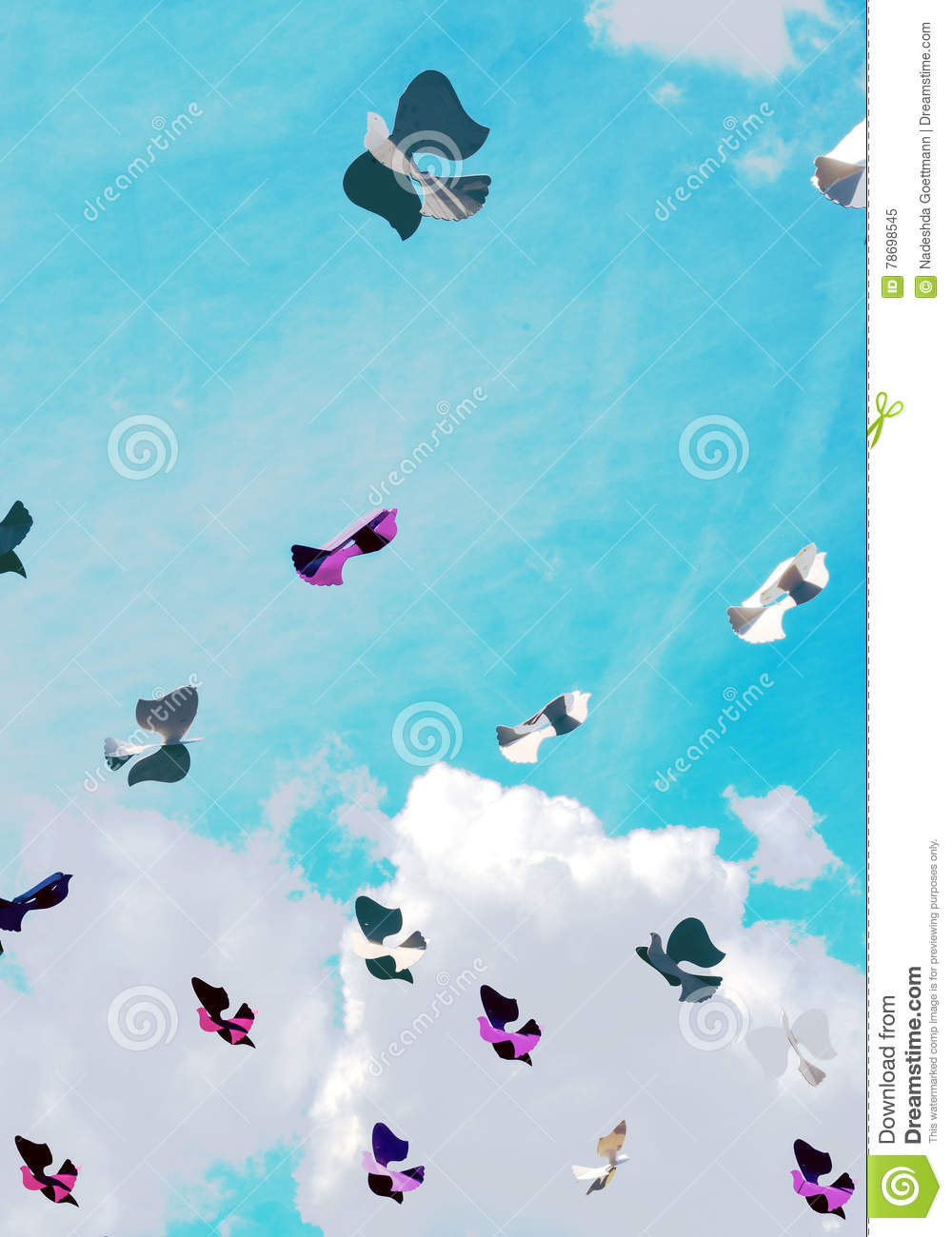 Paper bird in the sky with clouds
