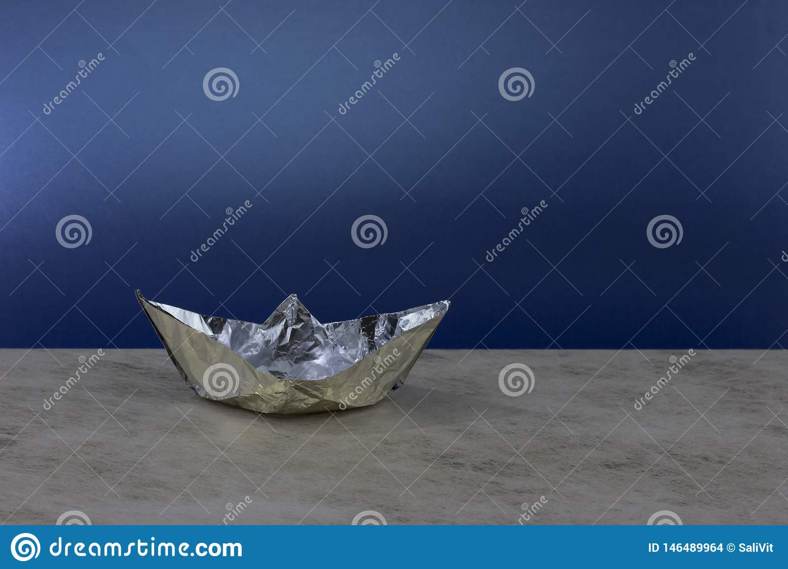Paper boat made of aluminum foil.