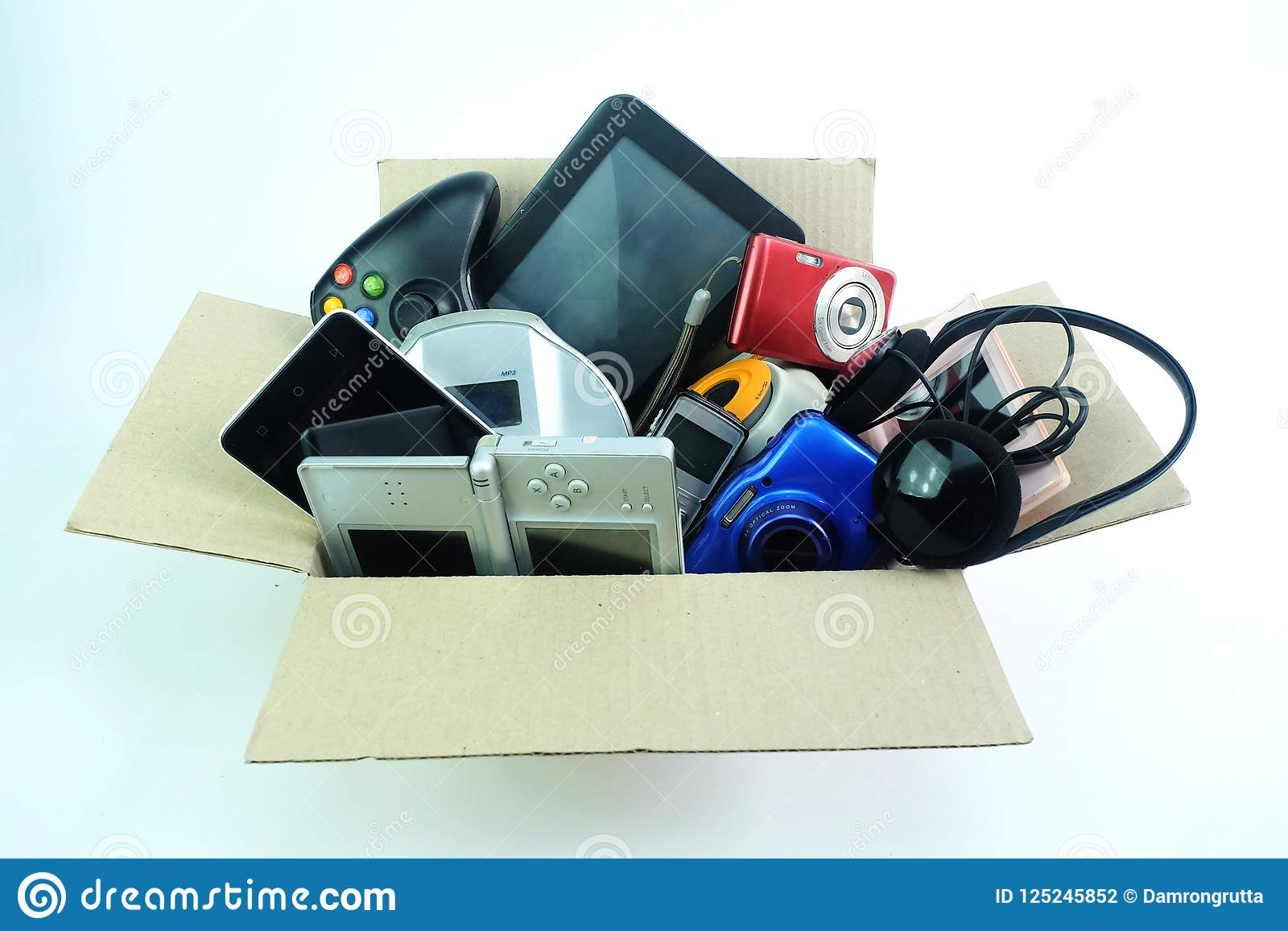 Paper box with the damaged or old used electronics gadgets for daily use on white background