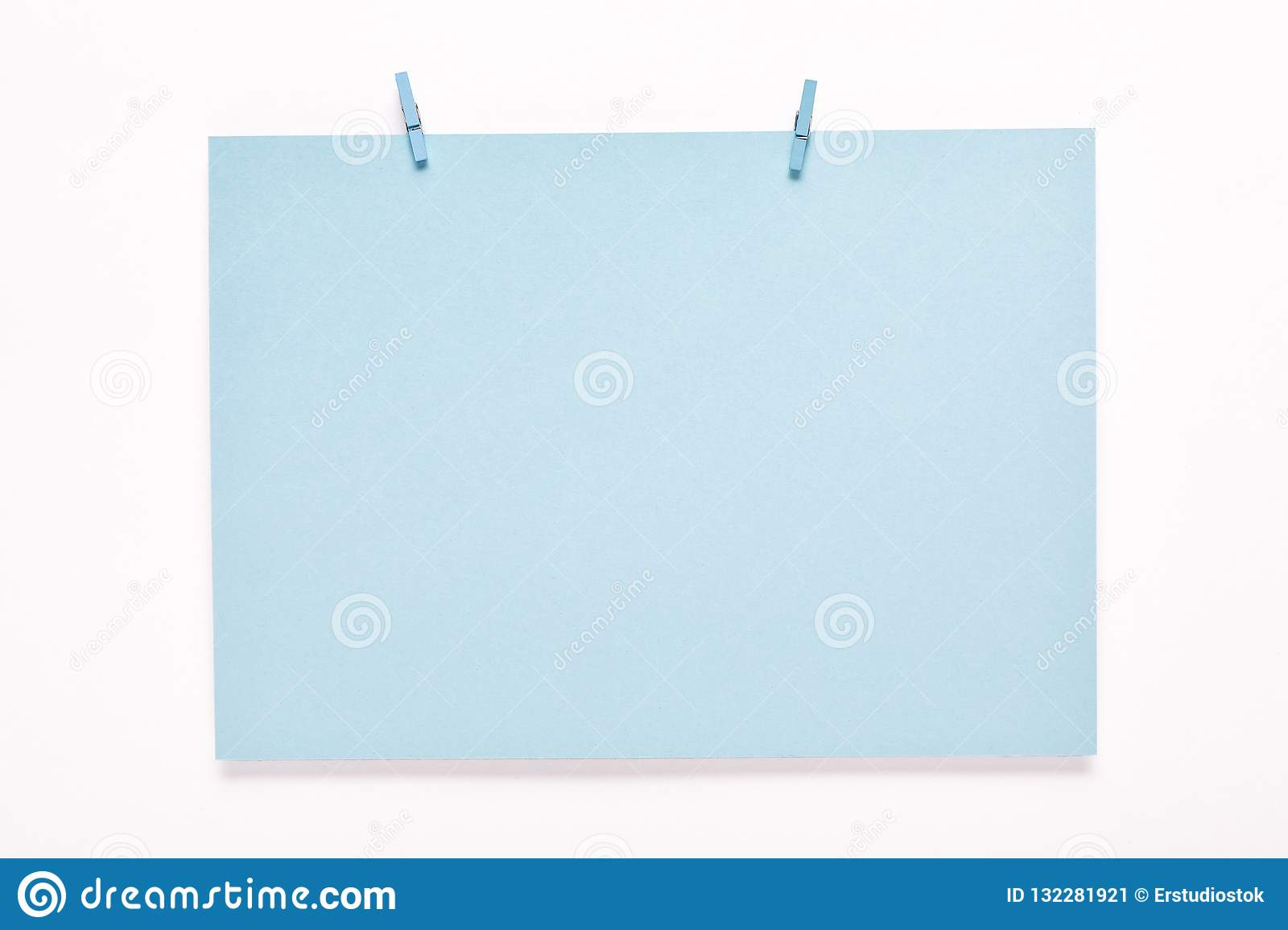 Paper card on clothes peg on white background