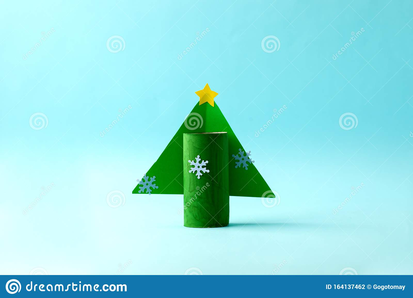 Paper Christmas Tree For Happy New Year Merry Christmas Party Easy Craft For Kids On Blue Background Simple Diy Idea From Toilet Stock Photo Image Of Child Happy 164137462