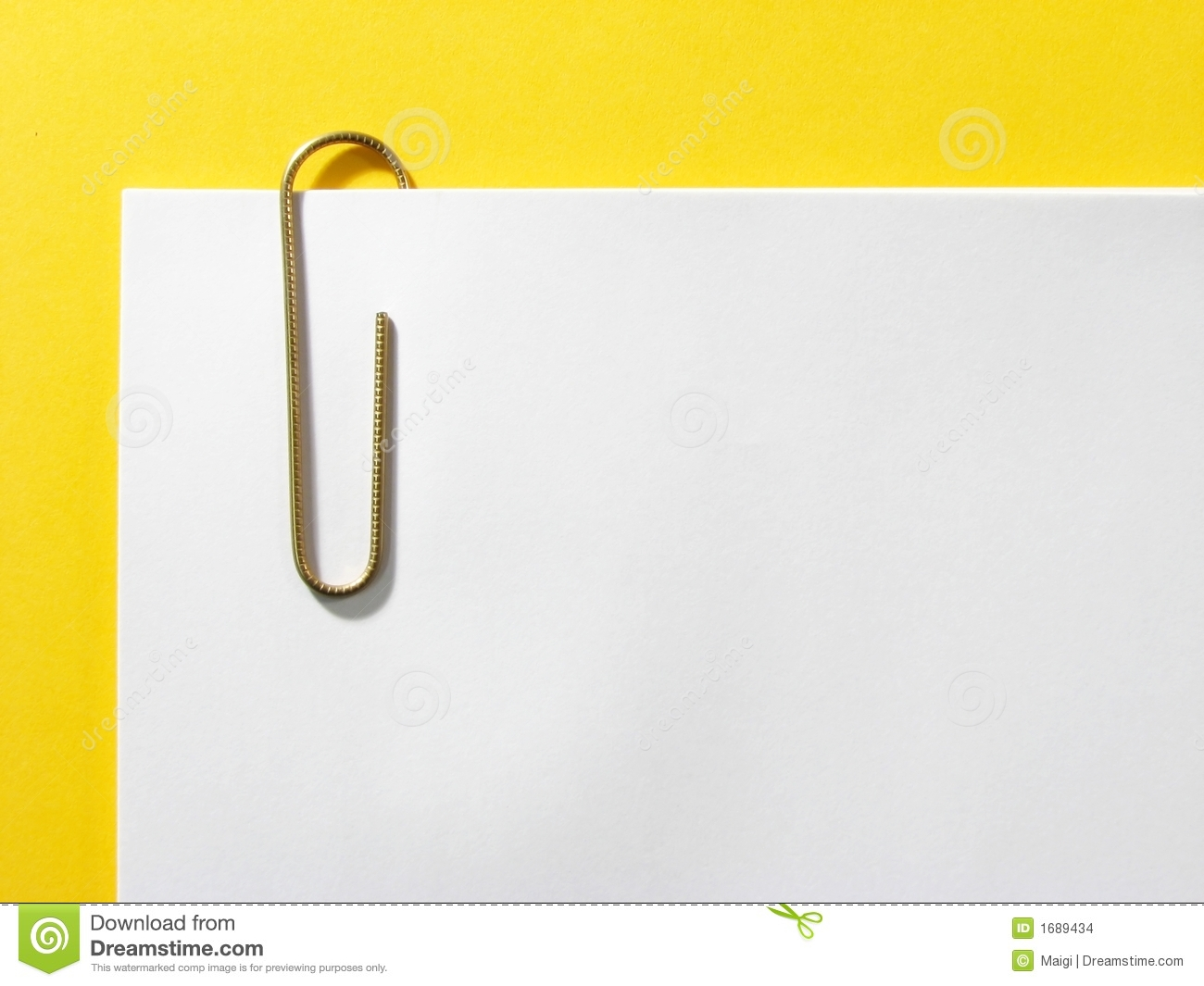 Paper clip holding papers together; yellow background.