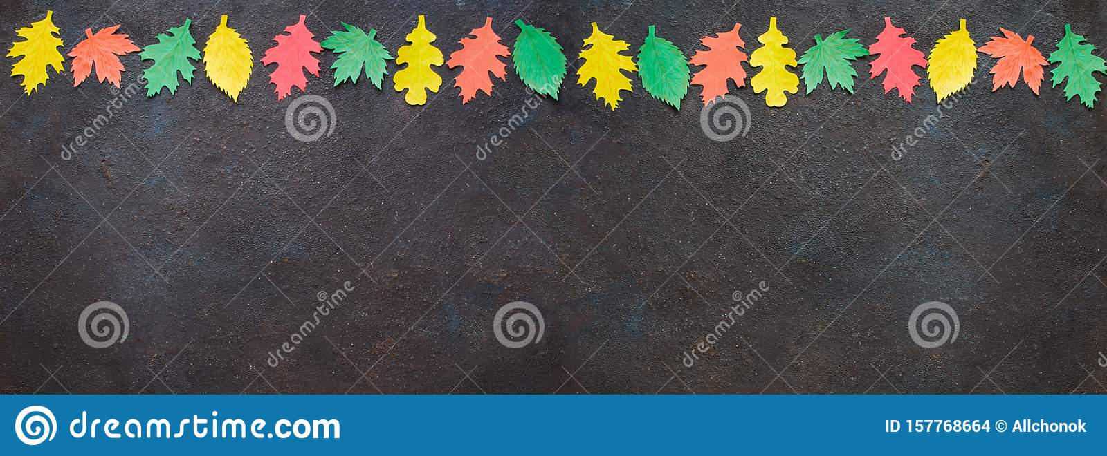 Paper craft, red and yellow Autumn leaves.Top view on flat lay on dark concrete background