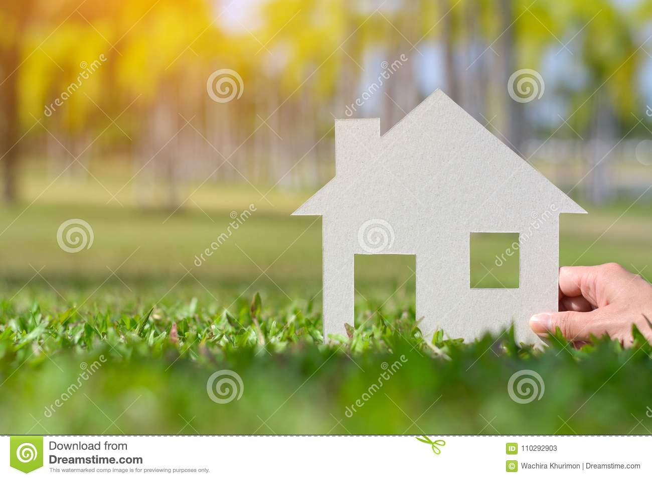 Paper cut of house on nature background copy space