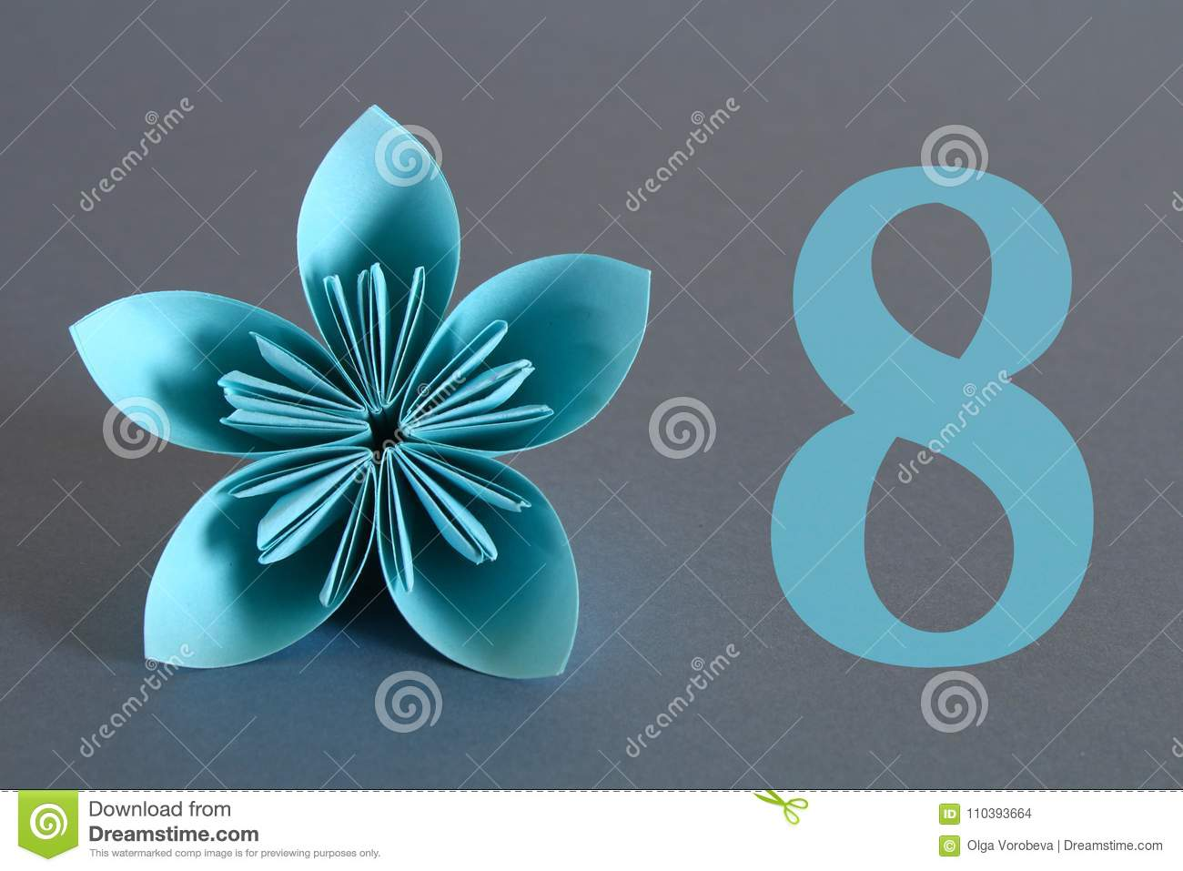 Paper Flower From Origami With The Number Eight On A Gray Background