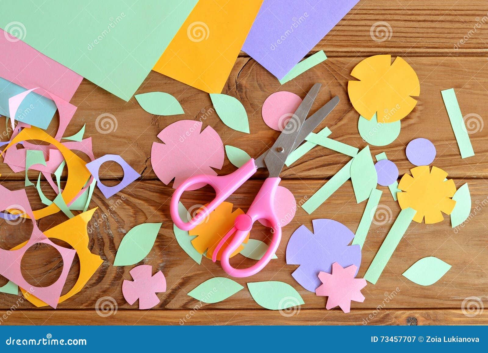 Paper flowers paper sheets scissors paper scrap on a wooden table paper flowers paper sheets scissors paper scrap on a wooden table mightylinksfo