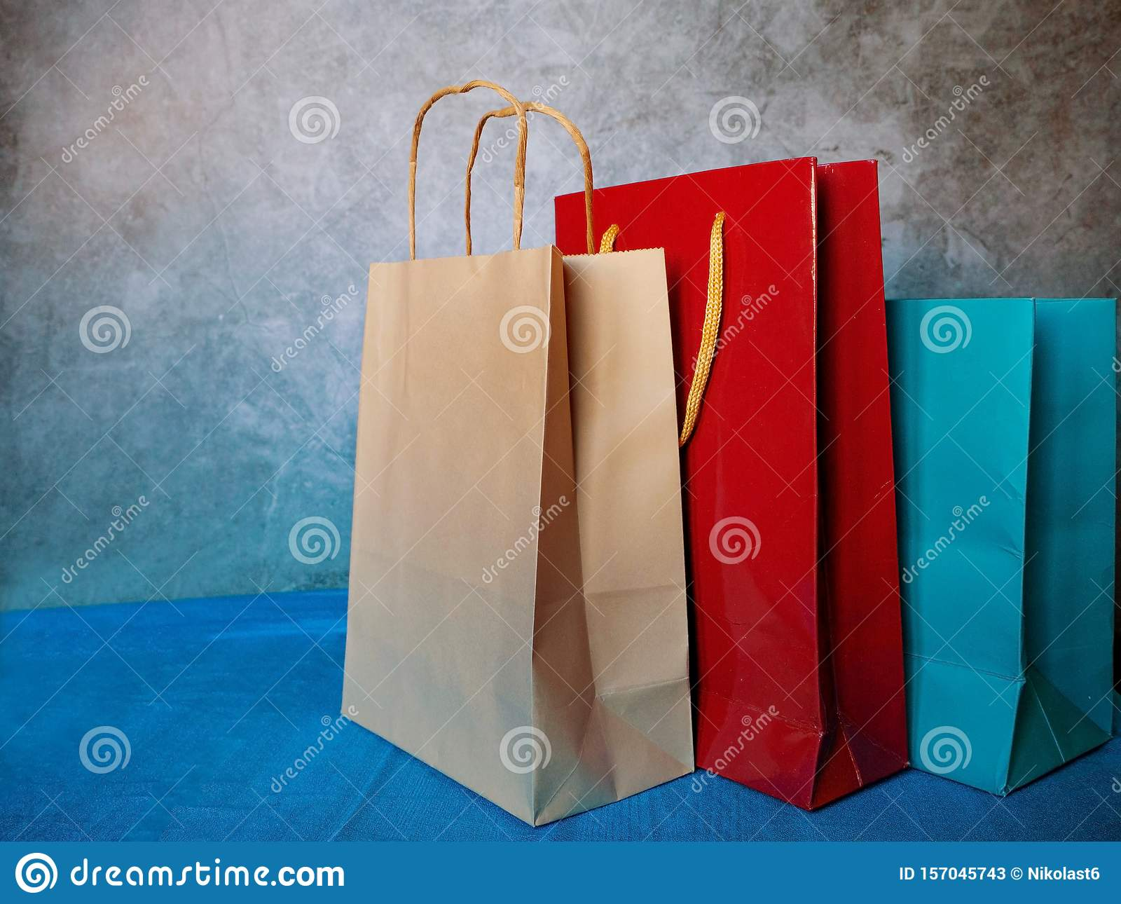 Paper Gift Bags With Rope Handles Three Blank Carry Bags On White Background Cropped Image Stock Image Image Of Birthday Retail 157045743