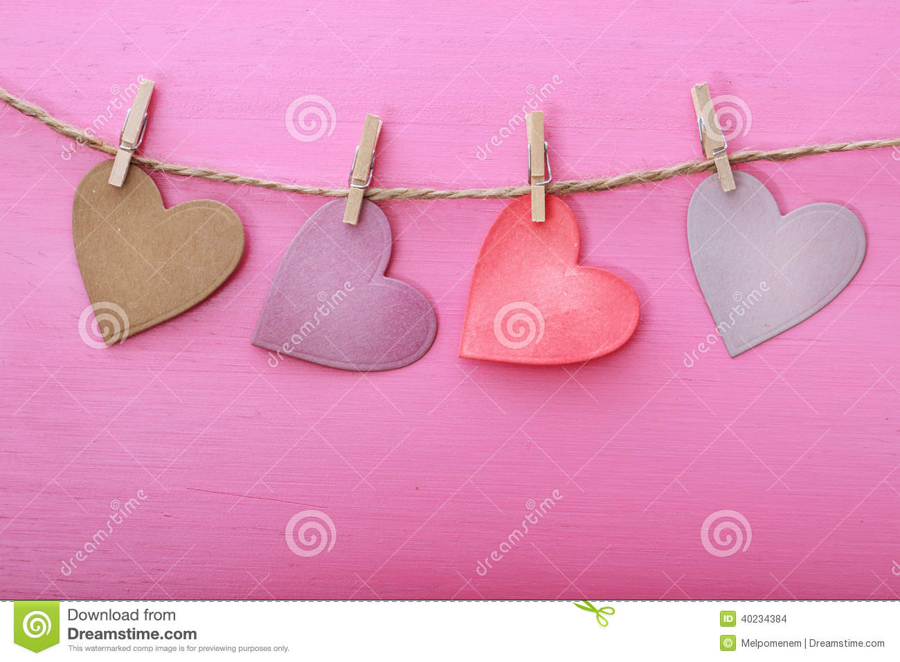 paper hearts hanging from string with clothespins stock