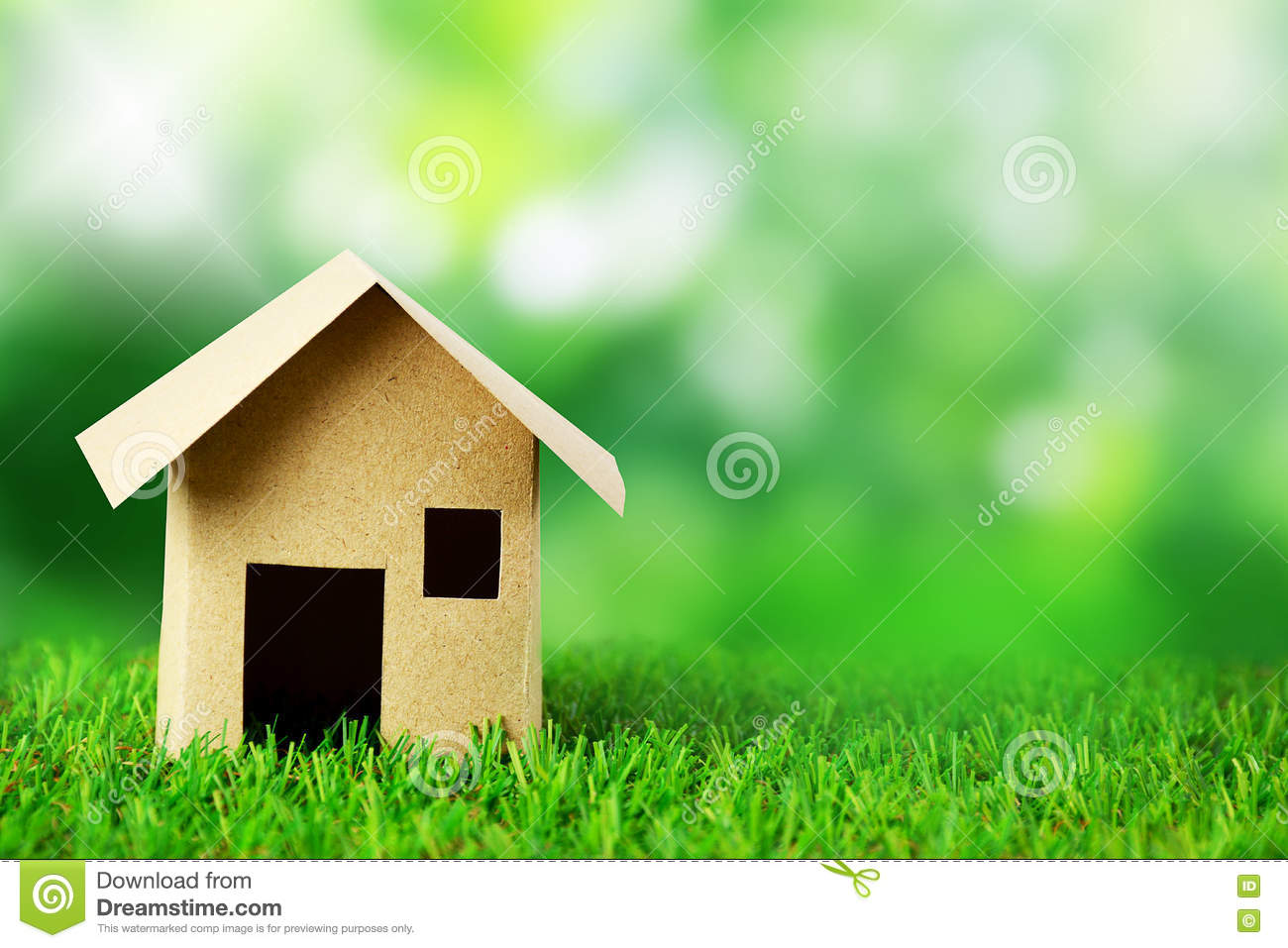 Paper House Model And Blur Green Background Stock Image