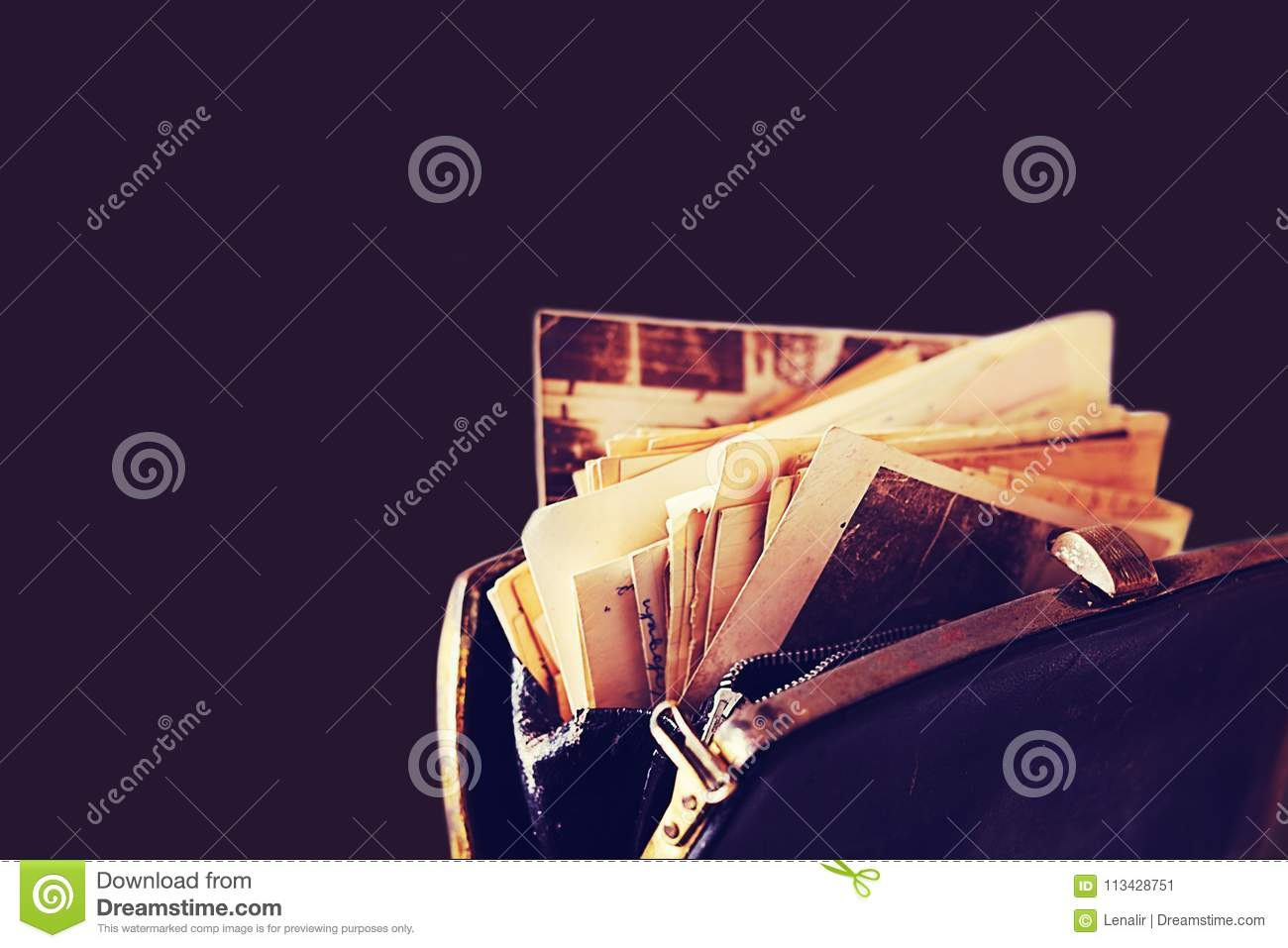 Paper letters and other old documents in the vintage handbag