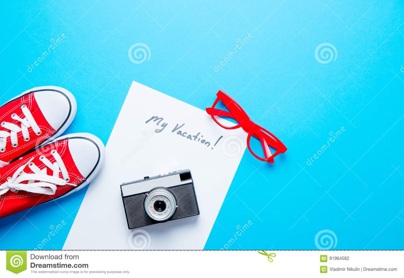 Paper My Vacation Camera Glasses And Gumshoes Stock Photo Image