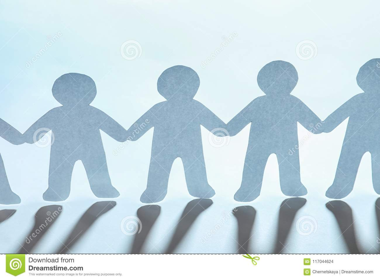 Paper People Holding Hands On Light Background Stock Photo - Image
