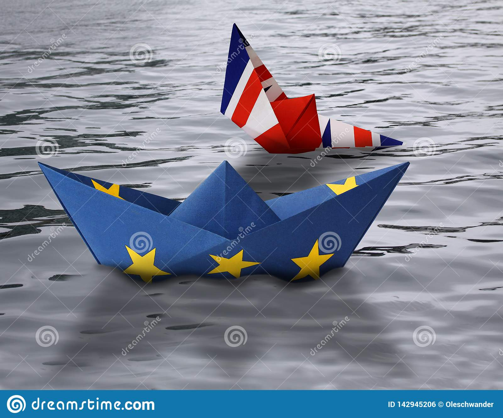 Paper ships made as European Union and British flags sailing side by side in the water - British ship sinking - concept showing En