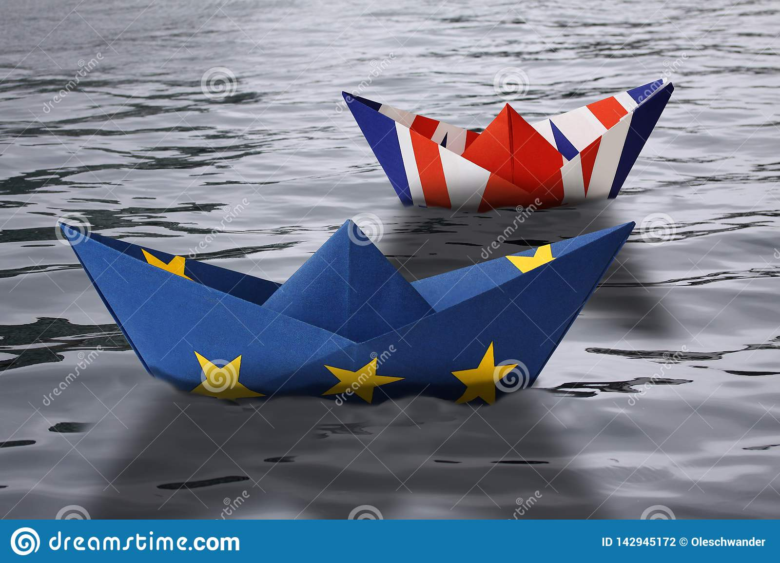 Paper ships made as European Union and British flags sailing side by side in the water - concept showing England and European Unio