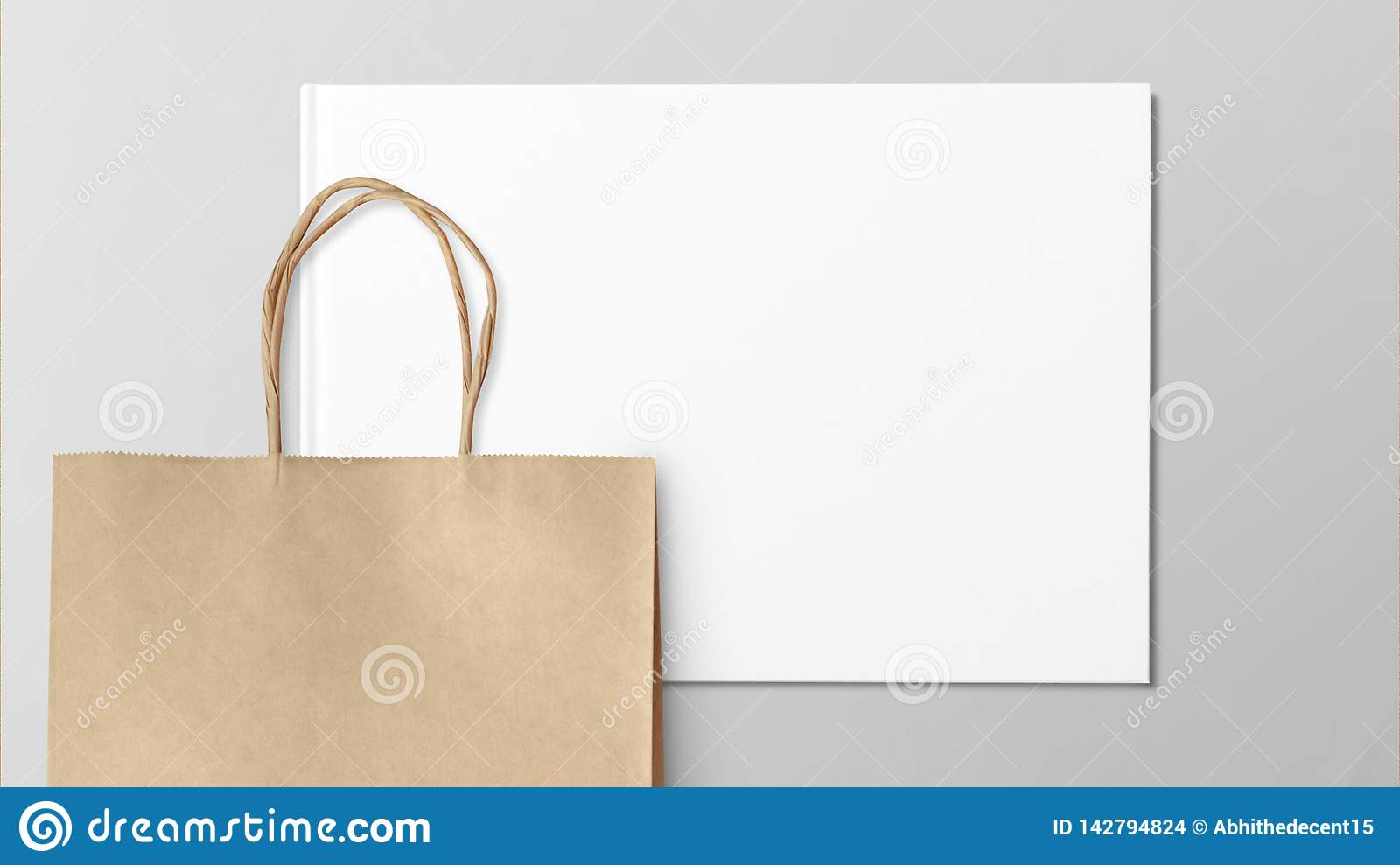 Paper shopping bag isolated on grey background