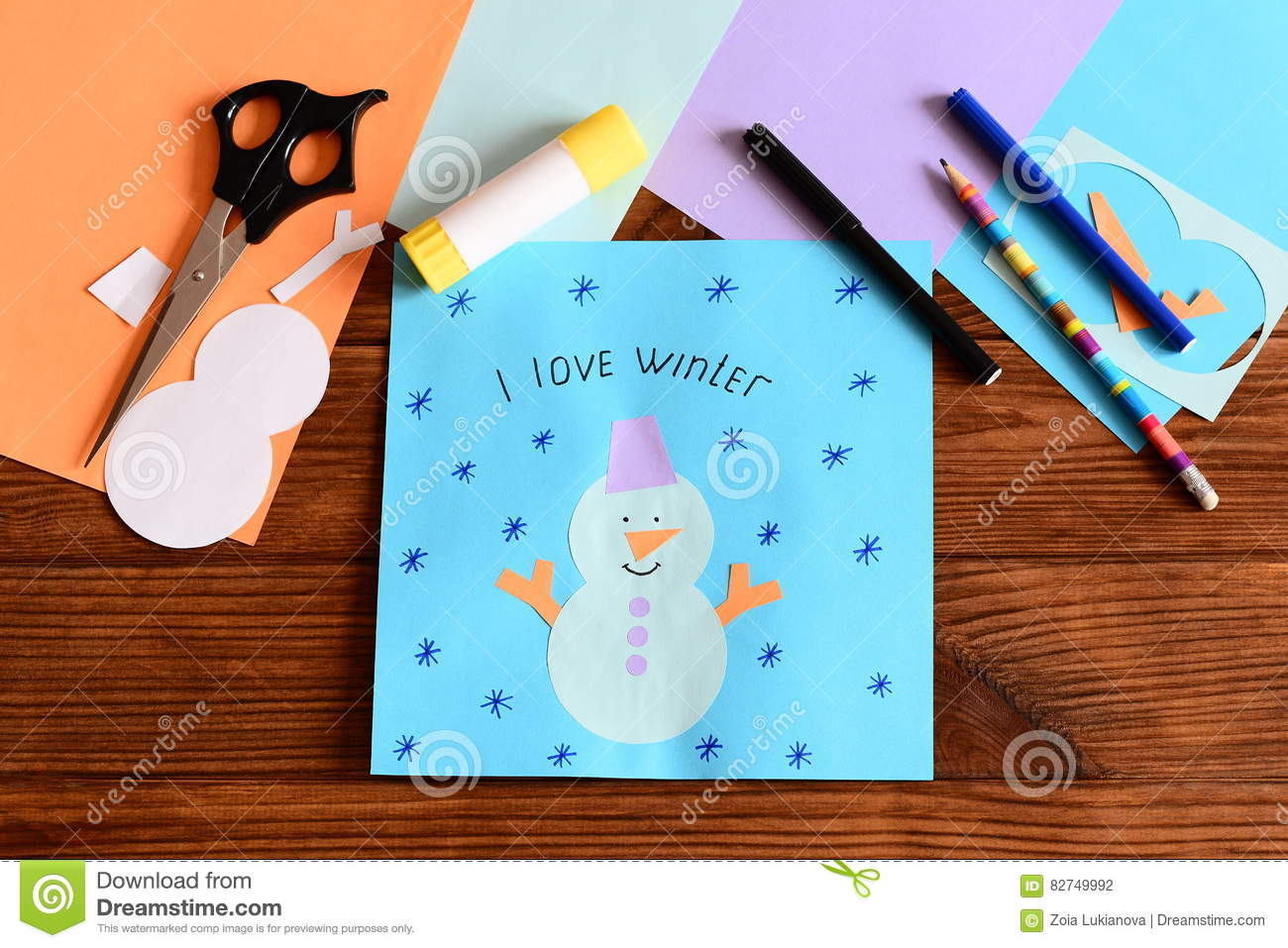 Paper snowman application card on wooden table tools and for Craft paper card stock