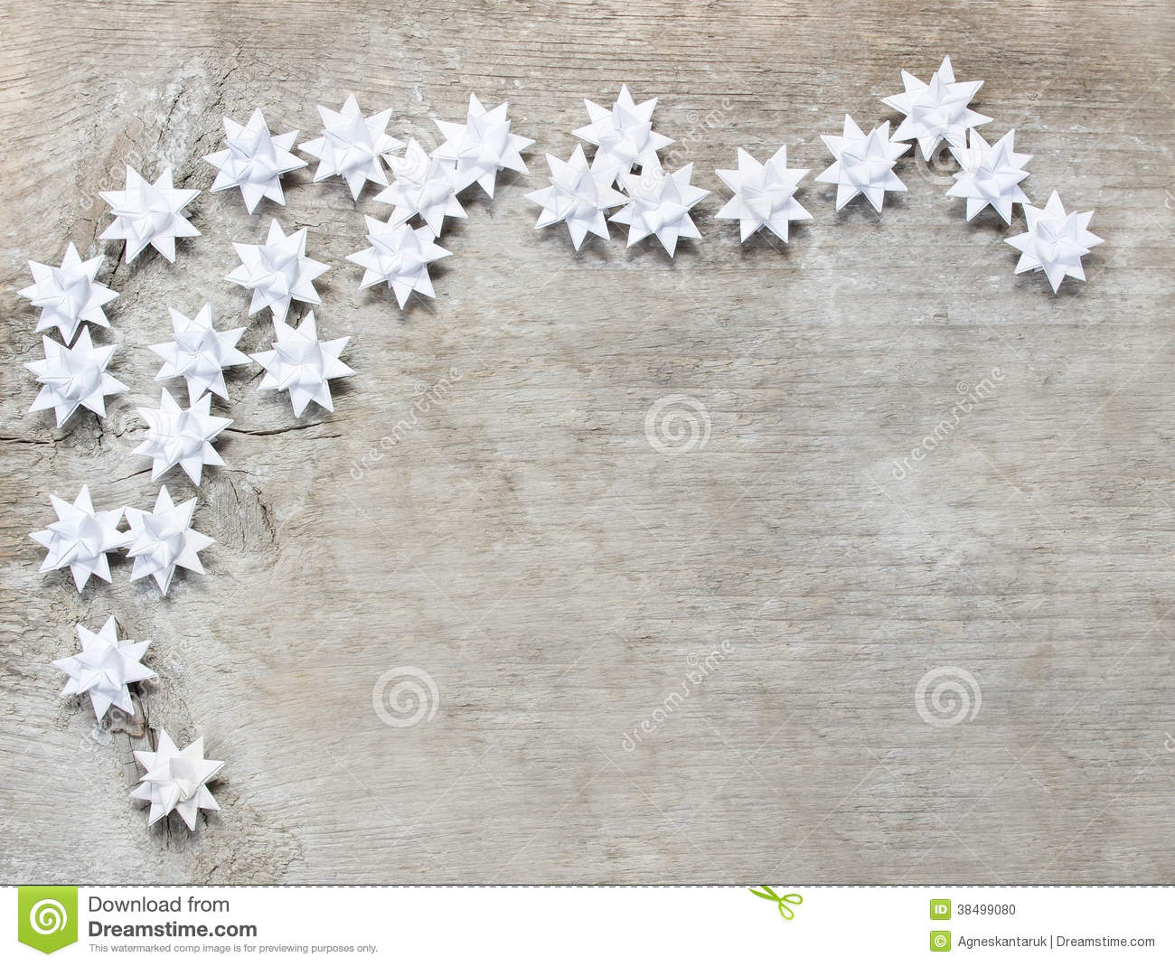 Paper stars on wooden rough background.