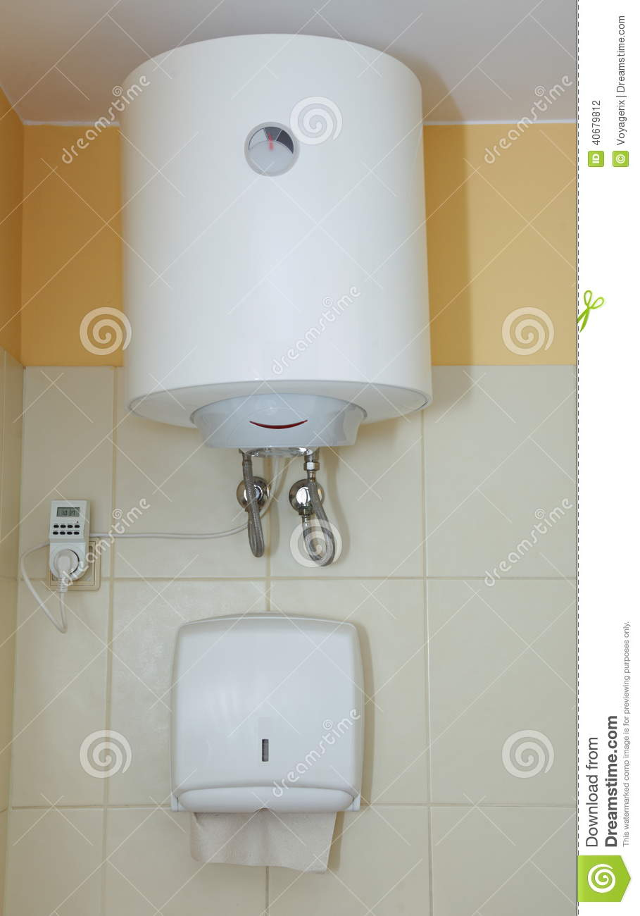 Electric boiler wall water heater in bathroom stock image for Heat bathroom
