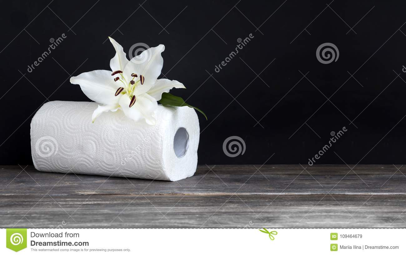 Paper Towel Roll Paper Tissue And Lily Flower On Table Against