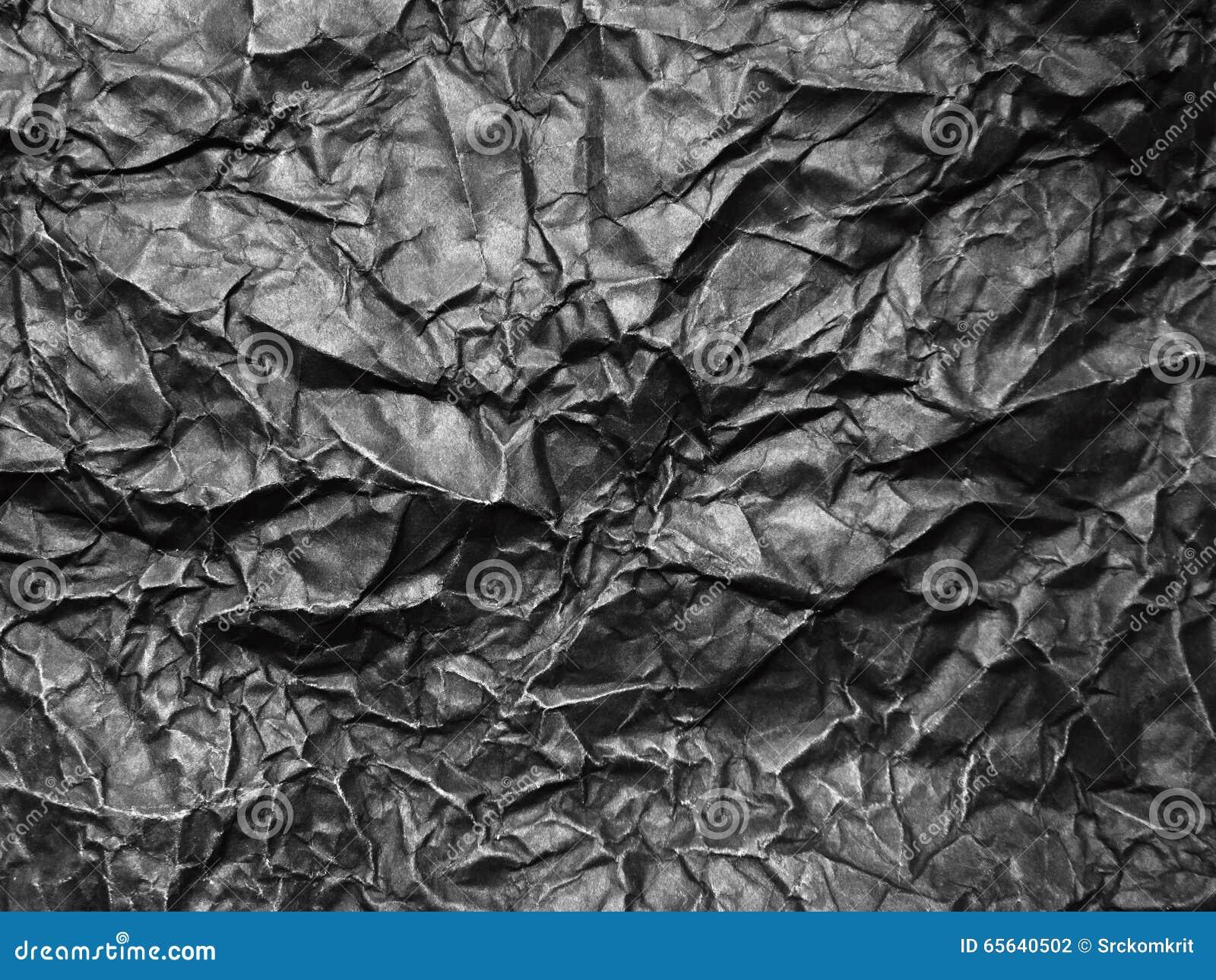 Papier noir chiffonné pour le fond
