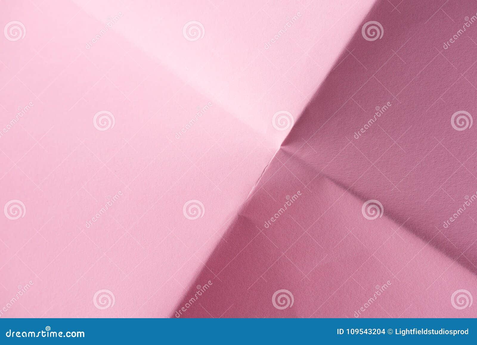 Papier rose plié pour le fond