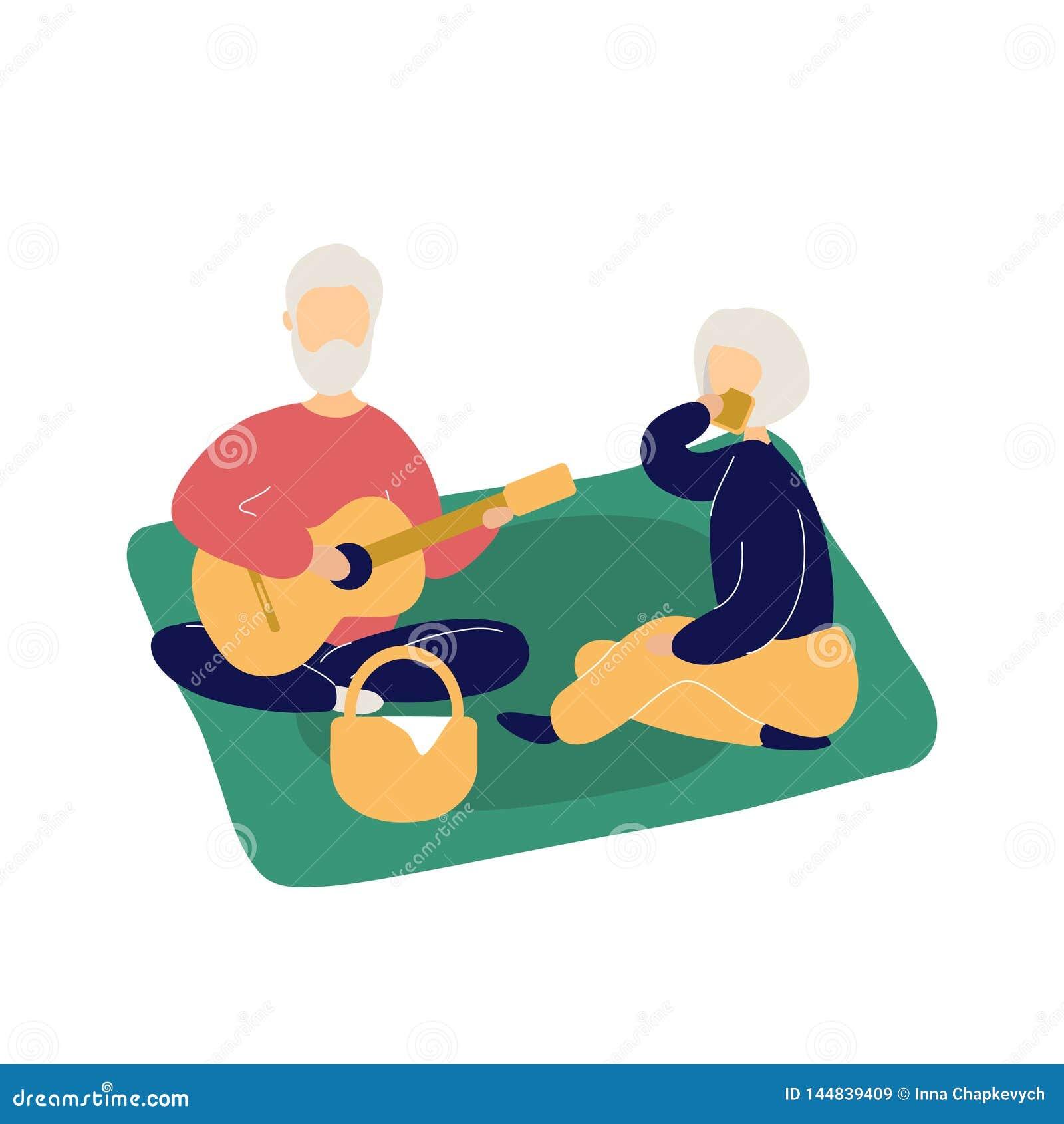 Par av gulligt äldre folk som har picknicken