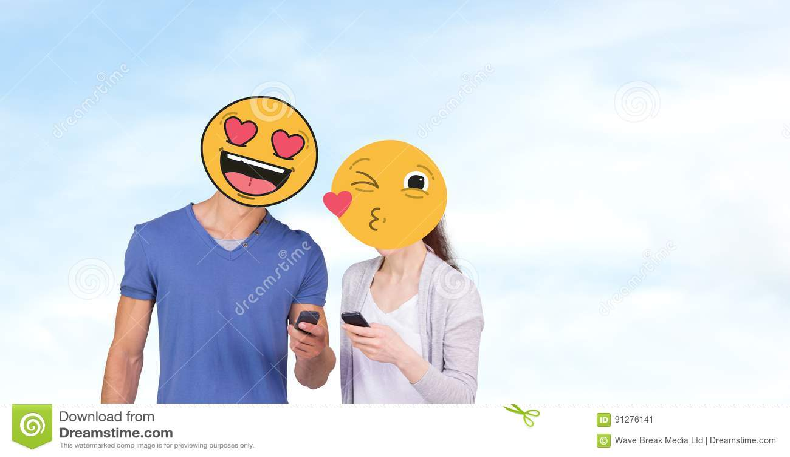 Par med emojis över framsidor genom att använda mobiltelefoner