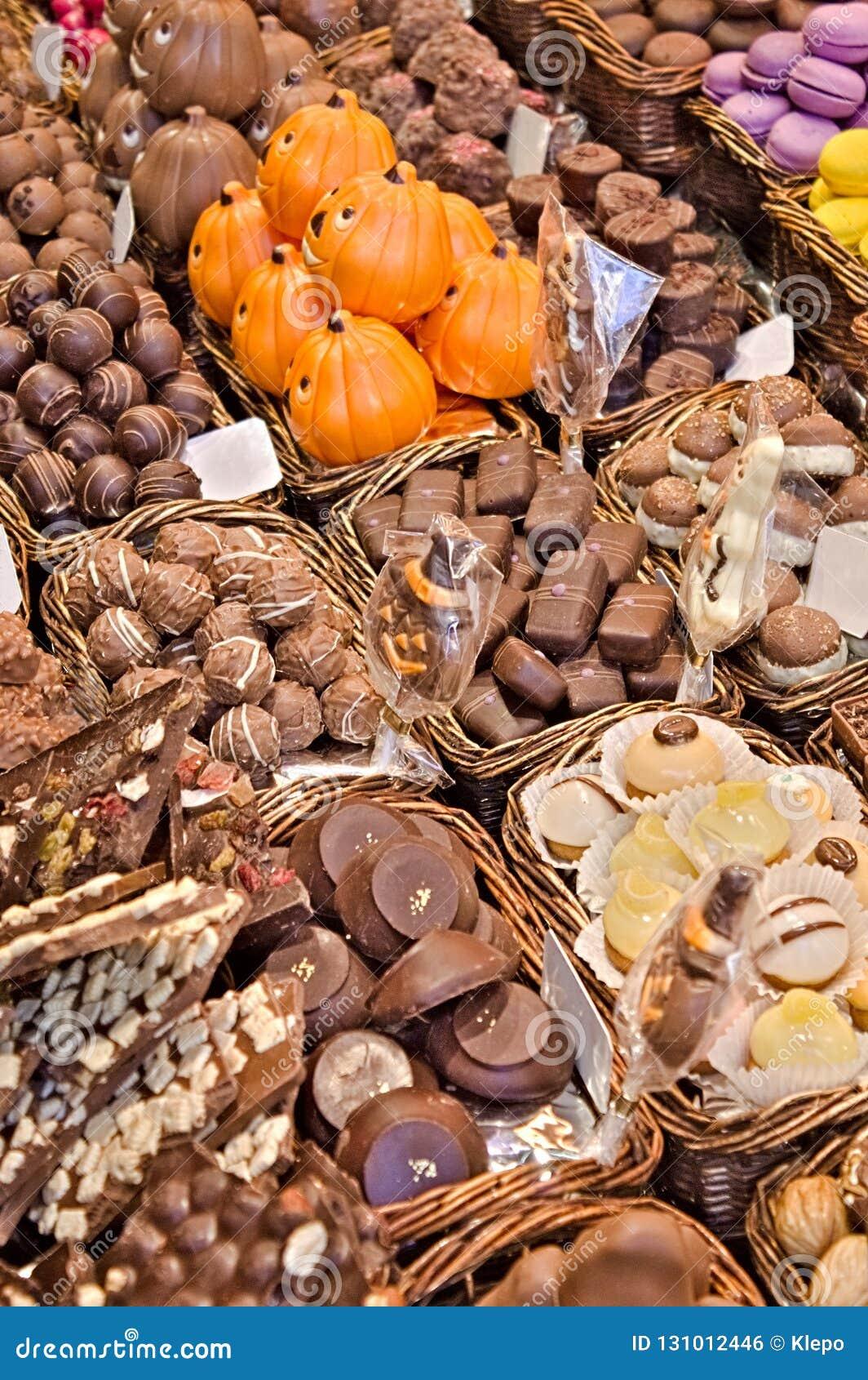 Paraíso do chocolate em umas caixas Confeitos de sorriso