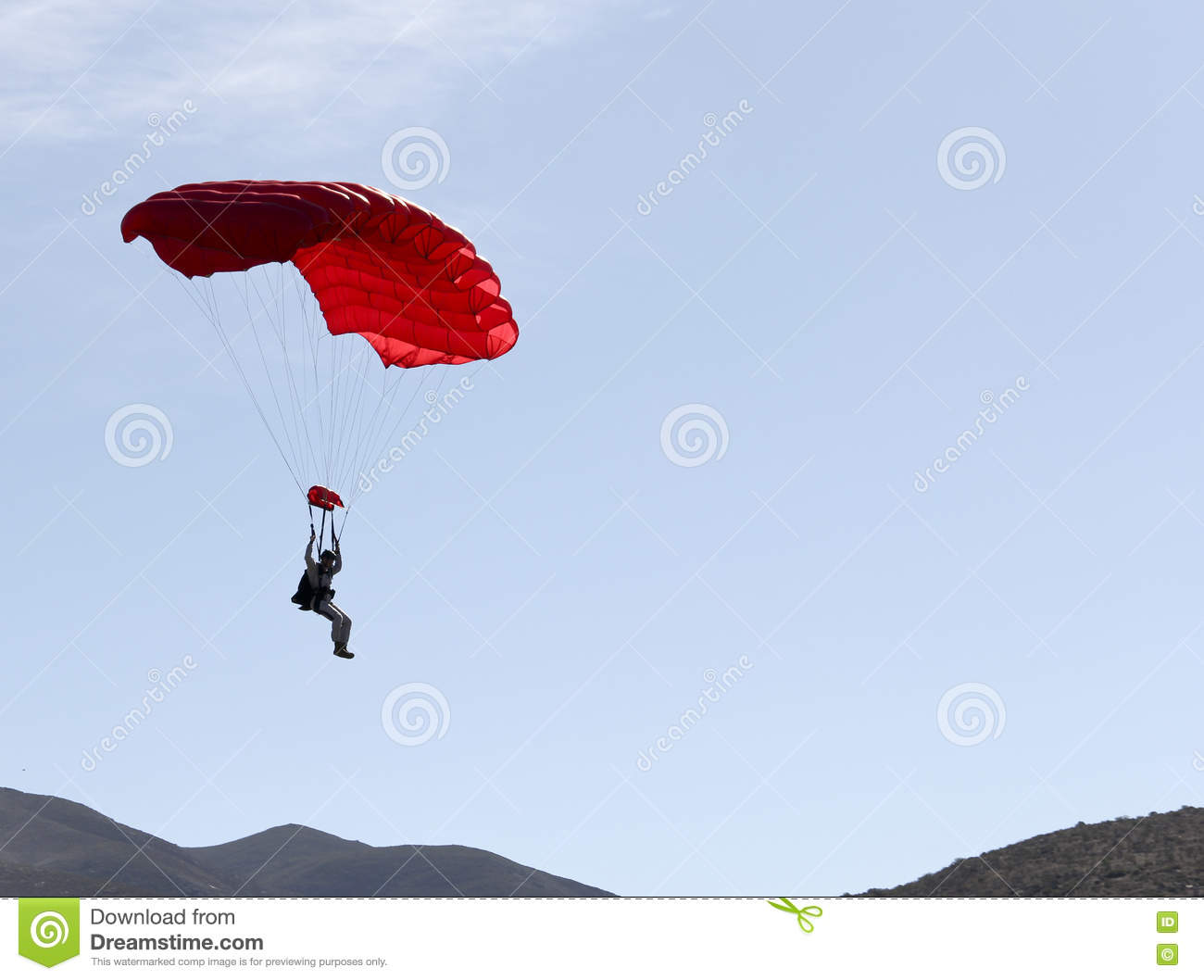 Parachute jumper floating to the ground